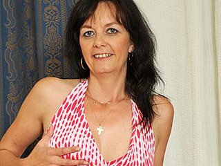 Darksome haired mother i'd like to fuck massages her titties and copulates a rabbit vibe