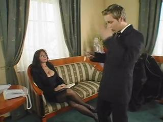 Breasty brunette MILF eats his cock and then gets fucked hard