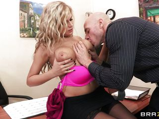 This cute blond doxy is staying at her desk and talking with a juvenile male. The man start kissing her sluggishly and gentile on her large boobs and is taking off her clothes. The blond allow this man to touch her cum-hole too and to finger her moist and taut vagina.
