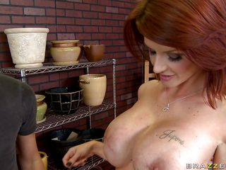Joslyn James is a redheaded hottie who's finished painting her vase. This babe tells the store owner she's done, but he has no glaze. Thankfully this babe has some, but it's not going to work on the vase. It will work, however, on her enormous breasts.