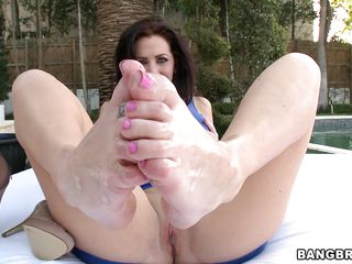 Jayden Jaymes is a hot brunette hair with magical feet that has no panties. Look how she gets her feet oiled during the time that she is clothed in a sexy blue outfit and gets ready for action. Look at her fingering her cunt during the time that he takes her feet and begins rubbing his knob between them. Will he cum inside of her?