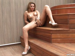 Isabella Medeiros knows how to make herself happy. She is a hot shemale with round boobs, long legs, big pecker and a very slutty face. See her in nature's garb hawt body as that babe rubs that hard dick with lust, is that babe going to cum on her hawt legs?