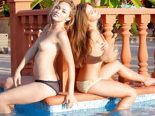See Guerlain and Madonna having a good time in the swimming water. They are all wet and playing with each other hawt bodies. See how they are kissing and laughing out of their hawt teasing. They are showing their small tits, groping each others gazoo as they are putting those bubble asses to the camera.