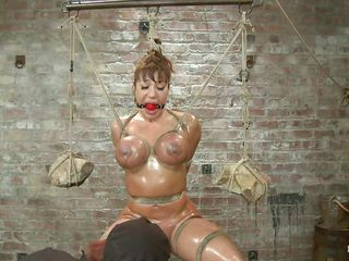 oiled breasty milf tortured