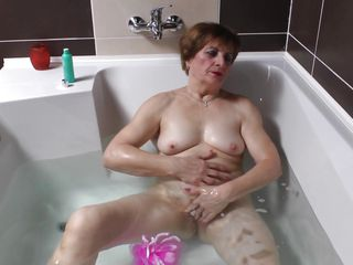 Watch this lewd 70 years old lady masturbating all alone while taking a bath. She is all naked, showing her chubby body and saggy tits. And in the tub water this lewd granny starts touching herself like a lewd whore. See how that babe is rubbing her clitoris and then fingers her vagina for satisfaction.