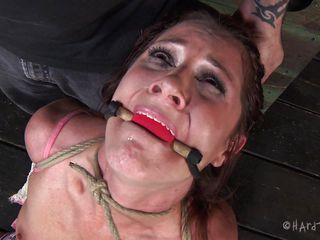 Knelt and destroyed she awaits for more. Her executor attached clamps on her nipples and pulls them hard inducing a lot of pain. She is being treated like a worthless slut, just the way she merits it. Now the man ties her legs and wants to hang her, wonder way? Keep on watching, this bitch won't get away easily
