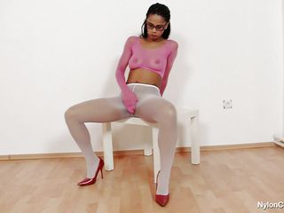 sexy dark brown covered in nylon masturbating on chair