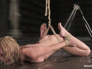 tied blonde taking a cold shower on the floor