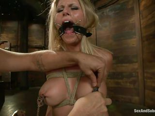 She's a blonde hottie and those large round mangos are asking for some attention. That babe acquires all the attention she deserves as the fellow puts clamps on her nipples and then copulates her face hole hard with his cock. Look at her gagging with that large dick while having a device that keeps her face hole opened, nice isn't it?
