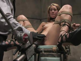 Calico gets her cum-hole fucked hard by that fucking machine, see how that vibrator enters her vagina deep, fucking this concupiscent slut until she screams with pleasure? The guy ties her pretty mouth and then another guy that is a technician operates the machine, giving this blonde a hell of a fuck. Do you enjoy seeing her hard nipps clamped and her sexy tights spread and tied?