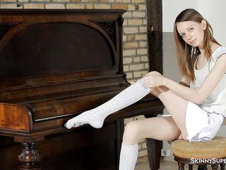 slender hotty at the piano behaves naughty