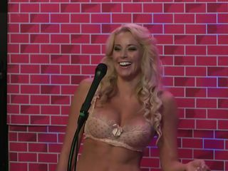 A hot blonde tells stories about her sexual experiences and fantasies. The guests and the male host assure her that this babe is going to fulfill those sexual desires with their help and this babe smiles. She also says that a better kisser is a woman coz this babe has soft lips. Wanna find out more about this sexy milf?