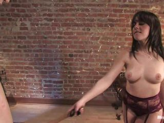 brunette gives some pleasure and pain to her fellow