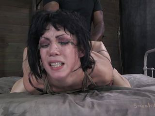 Brunette Noir made these two guys angry on her. They had enough with this cunt and decided to give her a punishment hard to forget. After the guys fastened her on the bed the black one started to drill her pussy while the white guy mouth fucked her. She's at their mercy and will obey until they will fill her with cum