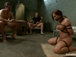 This brown hot doxy is a prisoner of this two guys. That babe is naked and bounded and this babe sits on the floor and waits to be punished by those dudes with large cocks. One of them fucks her throat and after that this guy penetrates her wet vagina. The slut screams of pleasure and this babe is ready for a threesome.