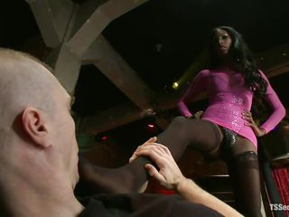 Ebon ladyboy slut with long dark hair, hot boobs and a hard cock that awaits obedience from this white man is dominating her sex slave with her feet, making him lick her toe and then her hard black penis. She takes great pleasure seeing the white gay engulfing her weenie like a submissive slut.