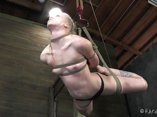 If you like blonde sluts hanged and brutally face hole drilled then this is for you. Sarah is a floozy and this guy wanted to treat her that way. He bound and hanged her, putted clamps on her pink teats and then rubbed her pussy. And because a bound blonde looks better with a ramrod in her face hole he drilled her in the throat!