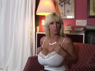 mature sluts from usa are known to be sexy and naughty. Here we have Tia Gunn, a blonde slut with huge bazookas and a lustful face that can give any guy an erection. She takes out her melons after a short talk and taunts us with 'em by squeezing 'em hard. Do you think this babe deserves a ramrod between her breasts and some semen?