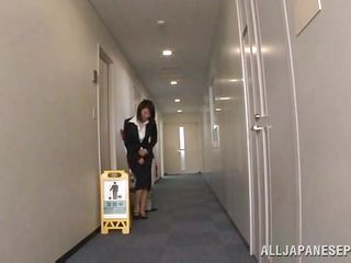 Japanese cunt wants to piss, but doesn`t know where. She asks a worker, but that guy doesn`t aid her and she pisses outside the building. He follows her and watches her. Then, that guy becomes so horny and begins to play with her wet pussy, recording it at the same time. They go to hide from others when she sucks his cock.