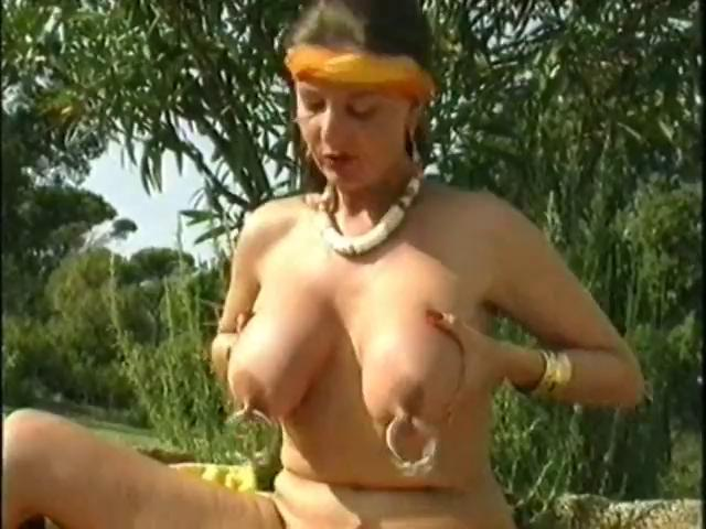 German woman plays with her large perforated nipps