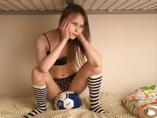 skinny chick plays with a soccer ball and her cunt