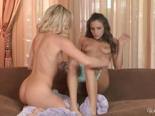 a brunette and blond helping out each other