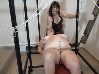 Some heavy duty ropes are used to tie this corpulent old granny and a solid metal frame. Vera is a biggest wench with heavy boobs and a passion for being dominated. Her headmistress give Vera what she wants more, some punishment. That babe uses clothespins to keep her pink wet pussy gaped and from now on things get's coarse