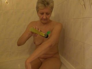 grandma masturbates in rub-down the shower