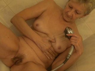 That babe may be old, saggy and wrinkled but grandma still knows how to masturbate. Here she is under the shower cleaning her old vagina and rubbing it hard. She's a old, horny slut with a lot of love to give so let's watch her as she masturbates for our pleasure. That vagina can still raise some cocks, doesn't it?