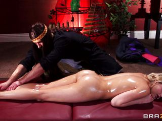 blond playgirl massaged with oil