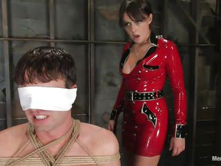 She removes the blind fold and allows him to see her sexy body and hot red latex costume. After ridding him and making his knob very hard that babe ties his dick and torture it inducing him a lot of pain. Look how that babe does her job perfectly and takes pleasure out of his pain. What else does that babe prepared him?