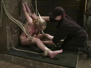 She's a natural beauty with small sweet breasts, pretty face and red hair. Her body is tense and punished as her executor, a brunette perverted lady performs her job perfectly and ties her milky body with rope then whips the hell out of her. She stays there in the position that babe was secured and without having the power to disobey, her torment continues.