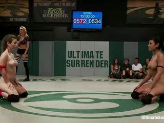 The match is intense and it seems that the referee is looking somewhere else 'cuz things are going wild in the arena. These bitches don't know the meaning of fair play and a girl comes in the help of the other one. Looks like anybody will need to surrender