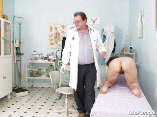 The doctor is checking her cookie with meticulous after he asks her to urinate in a bowl. He spreads her pussy lips and inserts a speculum in that hairy cookie for a good view of her cervix. Everything looks good and maybe that sight excites the doc, will she fill that pussy with his cum?