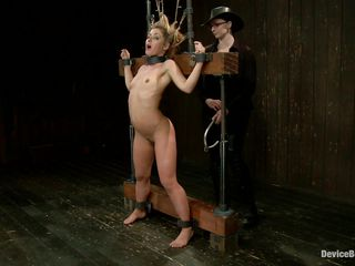 Cute blonde Sheena Shaw is tied up real hard on that servitude device. She get's her hairy pussy fingerd from behind and then the women inserts a tool in her tight anus, making this slut groan with pleasure. See how her hot butt takes it all. After getting prepared this babe receives a good whipping on these diminutive sexy tits making her nipples hard in advance of putting clamps on them.