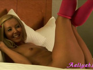 This hot blonde bitch wit a goddess body is in her large bed naked and wearing only a couple of red pantyhose. This babe has petite tits with nice nipples good for licking. In the room is a guy also that seems to be a photographer and that guy is shooting her hairless pussy and her body in all the positions.