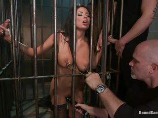 Now this is something that very guy wishes to have in his basement, a hot brunette in a cage and then, she's tied and ready to be fucked. These guys are not fooling around and the beautiful babe receives a hard fuck from behind and in her mouth. Do you like how they dominate her sexy ass?