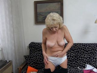 Granny needs to climax. She's horny and alone but this bitch has her dildo! This babe takes a sit on the couch, makes herself comfortable and then spreads her thighs as wide as this babe can. Then, the old whore sluggishly inserts the dildo in her saggy cunt and moans with delight. Enjoy yourself granny and be careful at those hips!