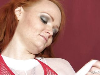 busty redhead masturbating with a obese dildo