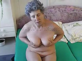 granny masturbates in front of the mirror