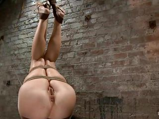 tied brunette hair receives a punishment that makes her ass red