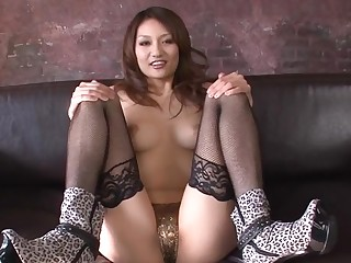 Pretty Oriental with lovely breasts entices with wet blowbang