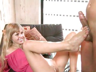 Sexy blonde wanks a cock with her sexy toes and feet
