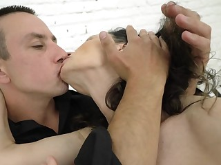 Granny with black hair is getting cumshot by a puerile dude