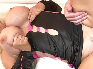 A hot milf is getting cum encompassing over the brush large fake silicone filled tits