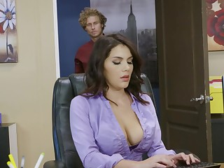 Busty bimbo is in the office and she is getting her wings on a dick