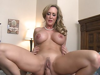 A blonde milf is getting penetrated missionary style by her stepson