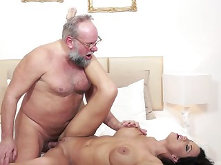 A busty woman with a big ass is feeling the love from an old dude