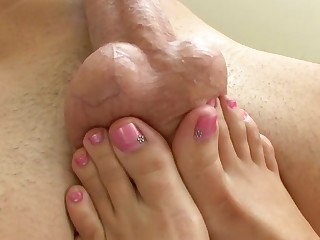 Girls sexy feet are working their magic on a load of shit and two balls