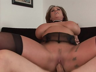 A hot milf with beamy chest is getting domesticated and fucked here her cunt